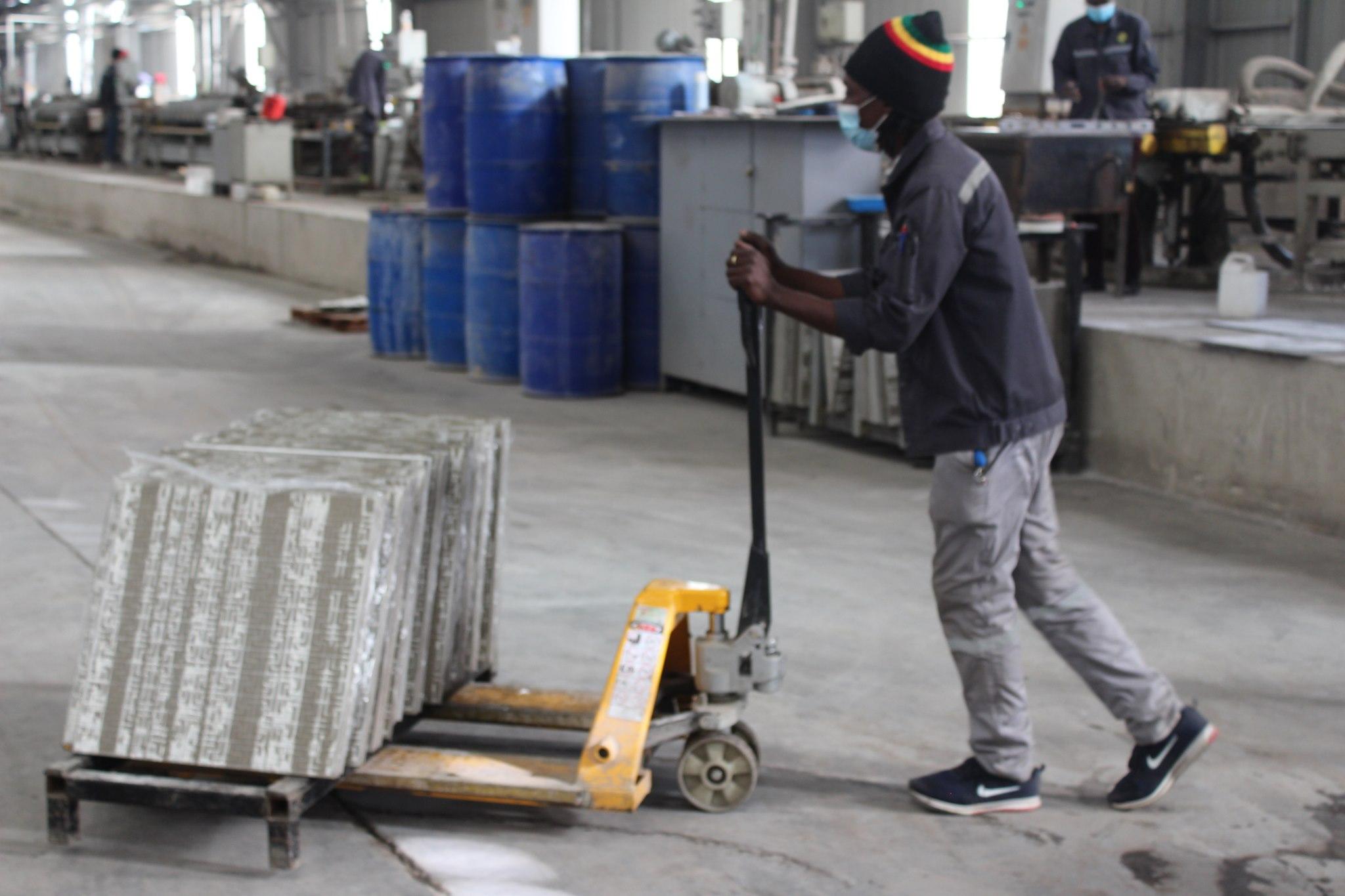 A Sunny Yi Feng Tile Zimbabwe employee working without adequate protective clothing